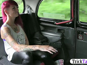 Naughty redhead punk chic showed her tattoo for a free ride