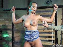 Bigtits babe flogged and bound in sex dungeon
