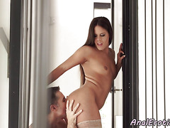 Stockinged beauty assfucked in doggystyle