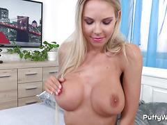 Blonde with nice curves masturbates