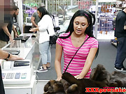 Pawnshop ethnic teen in store wanting cash