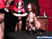 Busty redhead pussyrubbed in her hooker boots