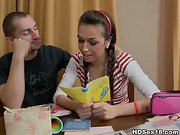 Girl with pigtails fucks on the table