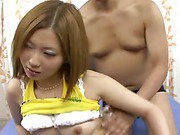 Lovely Shiho Kanou in her white bra and green panties has her beautifultits squeezed and her pussy pounded