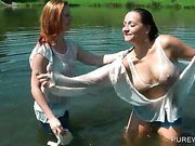 Lesbo hotties making out in a lake get real wet