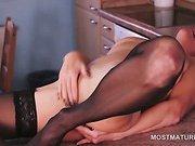 Stockinged mature masturbating reaches orgasm