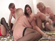 Orgy with matures sharing cock and fingering cunt