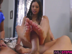 Lucys stepmom Syren shows her daughter how to give a footjob