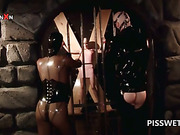 Sex slave in latex gets twat tortured for piss in BDSM scene