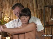 Tanned Euro beauty sucks masseurs cock