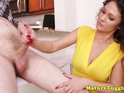 Milf jerking on cock before showing tits off