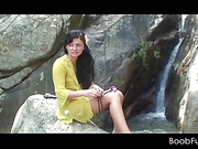 Amateur teen babe working her lusty twat by a waterfall