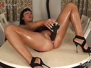 Masturbating slut enjoys her huge black dildo