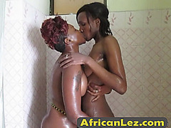 Look at these african beauties washing eachothers soapy boobs.