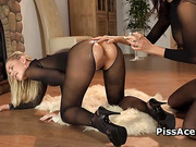 Babes in pantyhose piss in a bottle