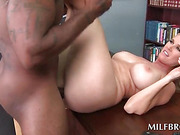 Curvy MILF fucked by black cock on the table
