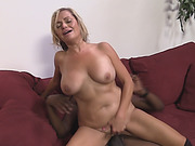 MILF with big tits fucks a long black dick in her office