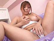 Busty Nene Azami slowly lets her big tits out of her bra before fingering her oiled pussy