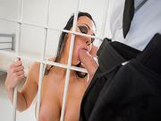 Danny D receives a blowjob behind bars from Aletta Ocean
