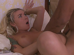 Dark-skinned guy kisses busty blonde tranny and sticks dick deep in ass