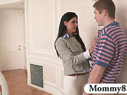 Frustrated MILF stepmom jerks off boy in the hallway when he comes to visit his girlfriend