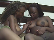 Busty ebony dykes Yvonne and Simone lick each other pussies in a bedroom