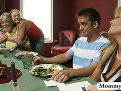 Mature stepmom jacks off teen boy under the table at dinner