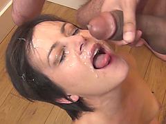 Slutty babes gives head and gets cum in bukkake