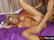 Stacked MILF plays with tits while getting screwed by younger stud
