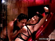 BDSM sexual torture scene with asian sex slave