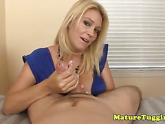 Hugetit cougar wanking hard cock to climax