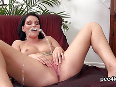 Glamorous kitten is pissing and pleasing hairless pussy